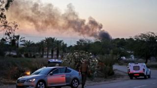 Smoke rises from rocket strike on kibbutz Kfar Aza in Israel (12/11/18)