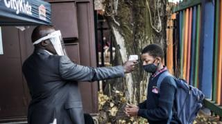 A child in Johannesburg has his temperature measured as he enters the school premises on June 1, 2020.