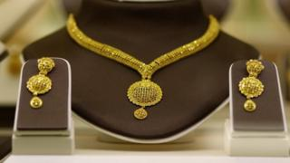 A gold necklace and earrings set