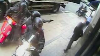 Moped drivers holding up pedestrians