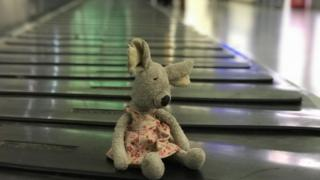 Mouse toy on luggage carousel