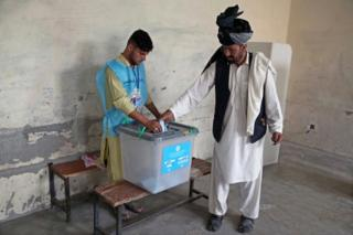 An Afghan man casts his ballot during the presidential elections, in Jalalabad, Afghanistan, on 28 September 2019