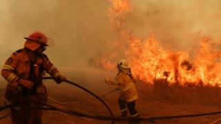 Australian firefighters battle a wildfire at close range earlier this month