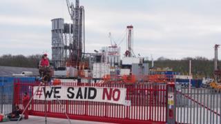 Protestors outside a drilling company