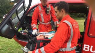 Kieron Robbins being taken to hospital