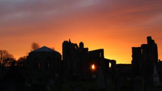 Sun rising over Elgin Cathedral ruins