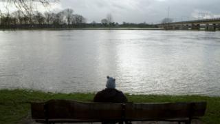 Aurelia Brouwers visits a lake near her home