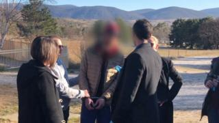 Detectives arrest Matthew James Williams (centre) in Jindabyne last year