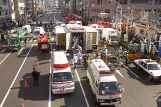 Rescue workers carry the survivors to the emergency rescue tents at Tokyo Metro Tsukiji Station on March 20, 1995 in Tokyo.