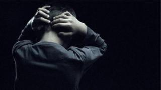 Man clutching head