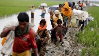 Rohingya refugees walk on the muddy path after crossing the Bangladesh-Myanmar border in Teknaf, Bangladesh, 3 September 2017