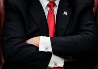 Donald Trump folds his arms