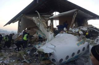 Emergency and security personnel are seen at the site of the plane crash near Almaty, Kazakhstan, December 27, 2019
