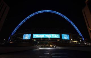 Wembley Arch lit up in blue