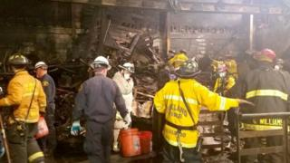 Firefighters inside the gutted Ghost Ship venue in Oakland, California. Photo: 5 December 2016