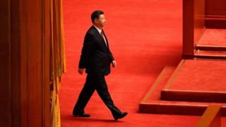 "This file photo taken on 1 August 2017 shows China""s President Xi Jinping arriving at a ceremony to commemorate the 90th anniversary of the founding of the People""s Liberation Army, at the Great Hall of the People in Beijing."