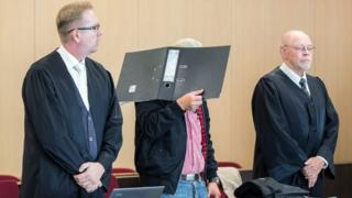 Defendant Ralf S is flanked by his lawyers Olaf Heuvens (L) and Gerhard Hauptmanns (R) at the district court of Duesseldorf, western Germany, on July 31, 2018,