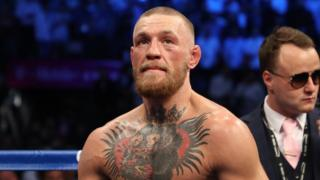 Conor McGregor pictured after being defeated by Floyd Mayweather Jr. in August 2017