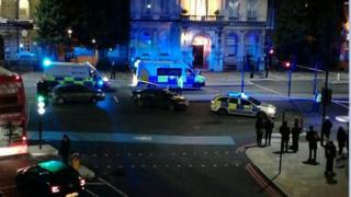 Scene after police officer is stabbed in Bow
