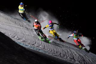 Tania Prymak of the USA, Marielle Thompson of Canada, Heidi Zacher of Germany, and Fanny Smith of Switzerland, from left, speed down the track during Ski Cross World Cup in Arosa, Switzerland