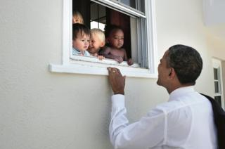 Obama looks through a window