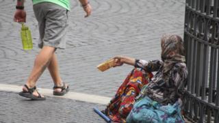 попрошайка в Италии