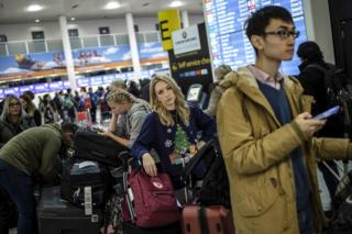 Passengers queue while waiting for announcements at Gatwick South Terminal on 20 December 2018