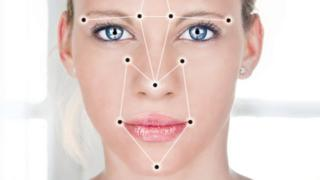 Woman's face superimposed with face detection points