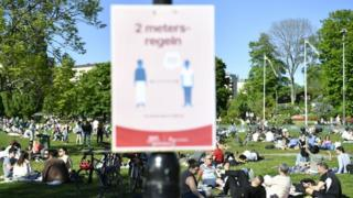 Social distancing signs at a Stockholm park