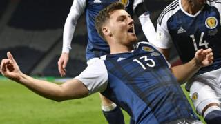 Chris Martin celebrates scoring Scotland's late winner against Slovenia