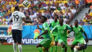 Super Eagles players contesting for di ball inside pitch.