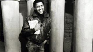 Obama as a student of Harvard Law School, where he became the first black president of the Harvard Law Review, of which he is holding a copy.