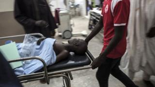 Sick person wey dey stretcher