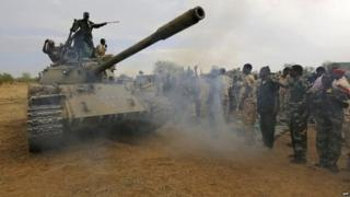 Sudanese soldiers celebrate after recapturing an area of South Kordofan from ethnic minority rebels - 20 May 2014
