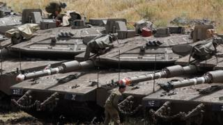 Israeli Merkava tanks and soldiers near the Syrian border in the Israel-annexed Golan Heights