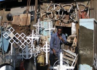 Stall selling crosses made from scraps of metal