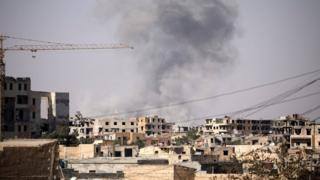 Smoke rises from a building in Raqqa on 31 July