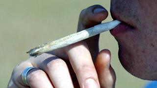 File Picture dated 29/10/2003 of an unknown man smoking a cannabis joint / spliff / bifter.