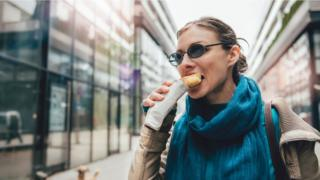 Woman eating a snack on the go