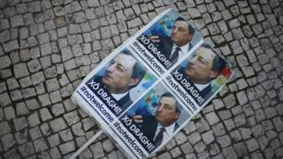 A placard is seen during a protest against the visit of European Central Bank (ECB) President Mario Draghi in Lisbon