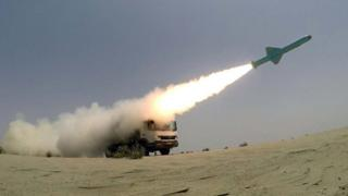 A handout photo shows a missile launched by a mobile launch vehicle during an Iranian military exercise in the Gulf of Oman (June 18, 2020).
