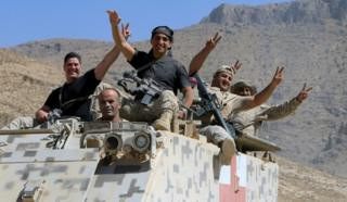 Lebanese army soldiers are seen flashing victory signs in the town of Ras Baalbek, Lebanon August 21, 2017.