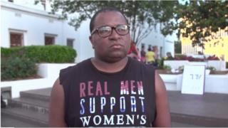 Travis, a pro-choice activist, protests in Alabama