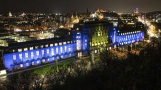 St Andrew's House, a Scottish Government building in Edinburgh, is illuminated in the colours of the European flag.