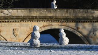 Snowmen on the banks of the River Cam in Cambridge
