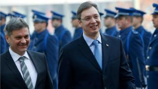 Serbian Prime Minister Aleksandar Vucic, right, accompanied by Bosnian Council of Ministers chairman Denis Zvizdic
