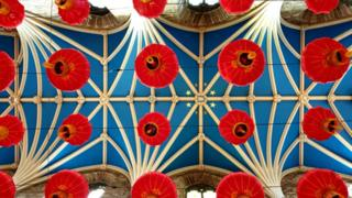 Chinese lanterns on cathedral ceiling