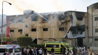 Egyptian emergency services battle a fire at a factory near Cairo