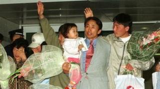 Беженцы из Северной Кореи в аэропорту Сеула