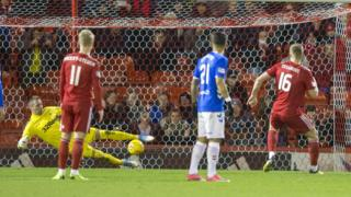 Aberdeen's Sam Cosgrove scores his sides second goal of the game from the penalty spot during the Ladbrokes Scottish Premiership match at Pittodrie Stadium, Aberdeen.